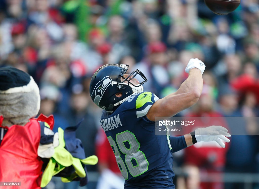 Tight end Jimmy Graham #88 of the Seattle Seahawks celebrates a touchdown during the fourth quarter of the game against the Houston Texans at CenturyLink Field on October 29, 2017 in Seattle, Washington.