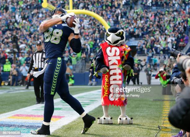 Tight end Jimmy Graham of the Seattle Seahawks celebrates his 1 yard touchdown during the fourth quarter of the game against the Houston Texans at...