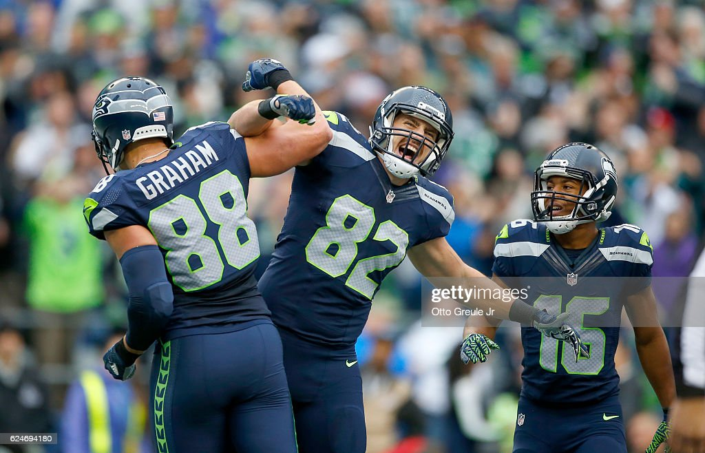Tight end Jimmy Graham #88 of the Seattle Seahawks celebrates his touchdown with teammate Tight end Luke Willson #82 against the Philadelphia Eagles at CenturyLink Field on November 20, 2016 in Seattle, Washington.