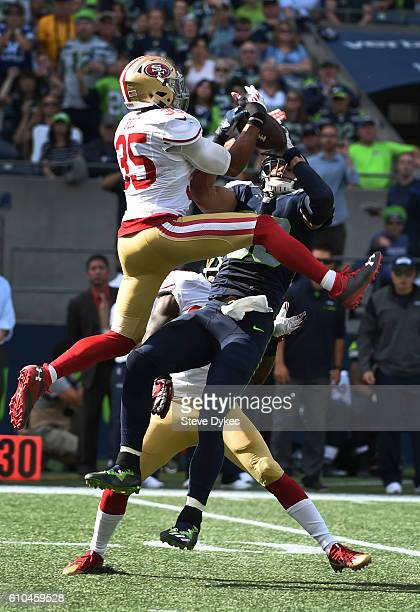 Tight end Jimmy Graham of the Seattle Seahawks grabs the ball away from free safety Eric Reid of the San Francisco 49ers for a long gain during the...