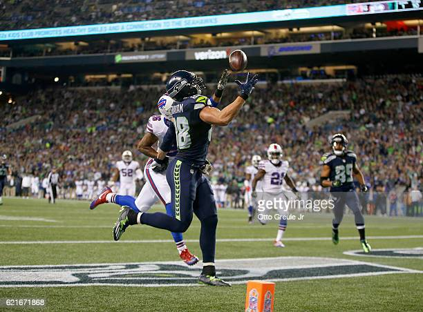Tight end Jimmy Graham of the Seattle Seahawks makes a touchdown reception against safety Robert Blanton of the Buffalo Bills at CenturyLink Field on...