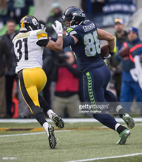 Tight end Jimmy Graham of the Seattle Seahawks runs with the ball after a reception as defensive back Ross Cockrell of the Pittsburgh Steelers tries...
