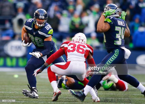 Tight end Jimmy Graham of the Seattle Seahawks rushes against safety Budda Baker of the Arizona Cardinals during the third quarter of the game...