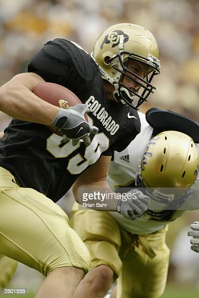 Tight end Joe Klopfenstein of the Colorado Buffaloes runs with the ball after making a catch against the UCLA Bruins on September 6 2003 at Folsom...