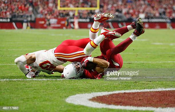 Tight end John Carlson of the Arizona Cardinals is hit by inside linebacker Josh Mauga of the Kansas City Chiefs on a twopoint conversion attempt in...