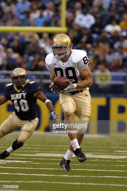 Tight end John Carlson of the University of Notre Dame Fighting Irish catches a pass during a game on October 28 2006 against the United States Naval...