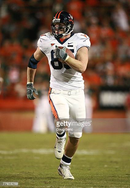 Tight end John Phillips of the Virginia Cavaliers looks for room to run against the Miami Hurricanes at the Orange Bowl on November 10 2007 in Coral...