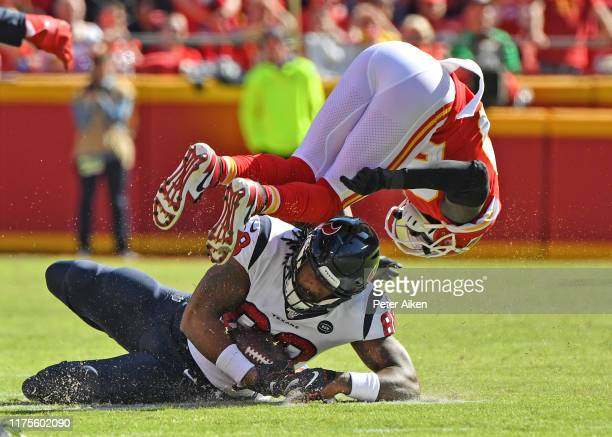 Tight end Jordan Akins of the Houston Texans catches a pass under cornerback Morris Claiborne of the Kansas City Chiefs during the second half at...