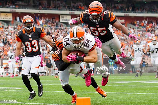 Tight end Jordan Cameron of the Cleveland Browns dives for extra yards while under pressure from free safety Reggie Nelson outside linebacker Vontaze...