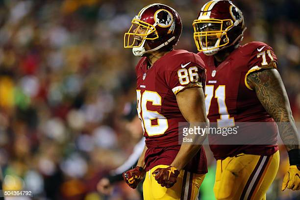 Tight end Jordan Reed of the Washington Redskins celebrates with teammate tackle Trent Williams after scoring a second quarter touchdown against the...