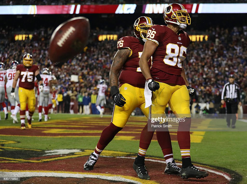 Tight end Jordan Reed #86 of the Washington Redskins celebrates with teammate tackle Morgan Moses #76 after scoring a fourth quarter touchdown against the New York Giants at FedExField on January 1, 2017 in Landover, Maryland.