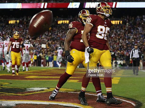 Tight end Jordan Reed of the Washington Redskins celebrates with teammate tackle Morgan Moses after scoring a fourth quarter touchdown against the...