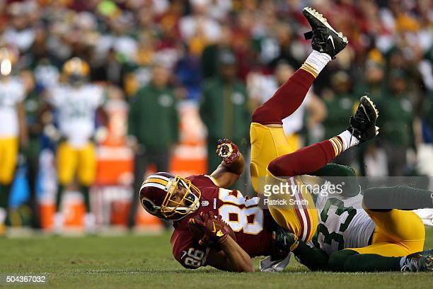Tight end Jordan Reed of the Washington Redskins is tackled by strong safety Micah Hyde of the Green Bay Packers in the first quarter during the NFC...