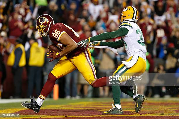 Tight end Jordan Reed of the Washington Redskins scores a second quarter touchdown past strong safety Micah Hyde of the Green Bay Packers during the...