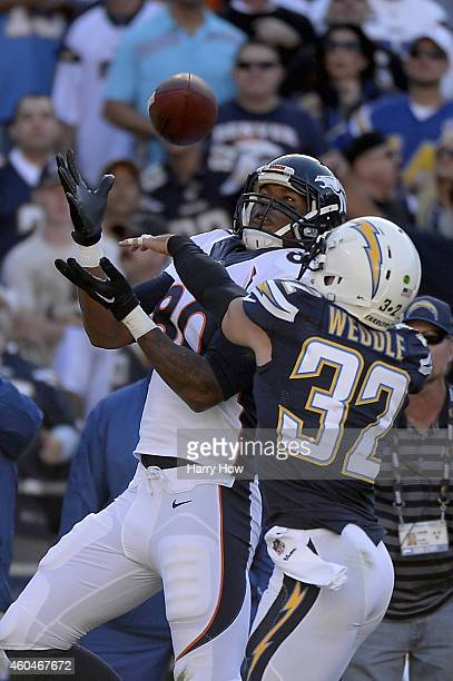 Tight end Julius Thomas of the Denver Broncos makes a 30yard pass reception over free safety Eric Weddle of the San Diego Chargers at Qualcomm...