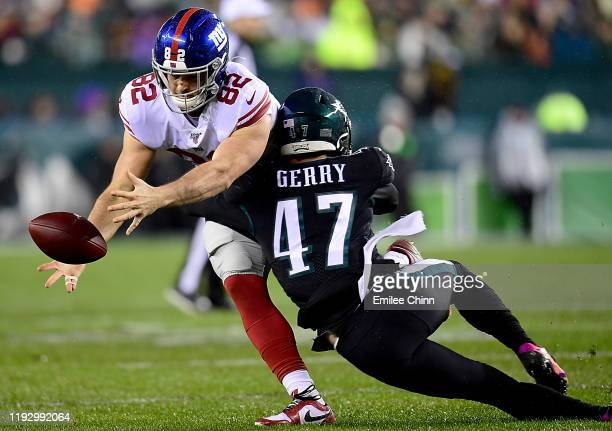 Tight end Kaden Smith of the New York Giants fumbles the ball on a hit by linebacker Nate Gerry of the Philadelphia Eagles in the first quarter of...