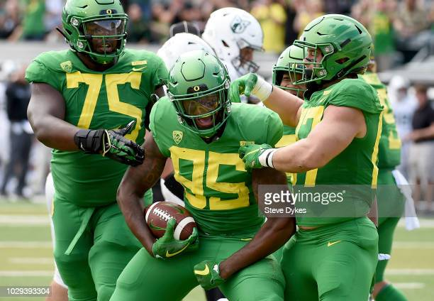 Tight end Kano Dillon of the Oregon Ducks celebrates after scoring a touchdown during the second quarter of the game against the Portland State...
