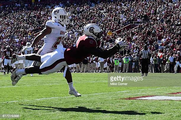 Tight end KC Crosby of the South Carolina Gamecocks makes a touchdown reception against the Massachusetts Minutemen at WilliamsBrice Stadium on...