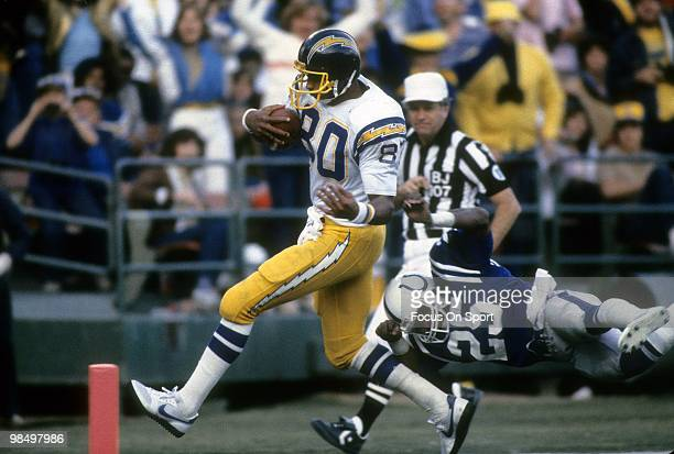 Tight End Kellen Winslow of the San Diego Chargers beats Nesby Glasgow the Baltimore Colts to the endzone circa 1982 during an NFL football game at...
