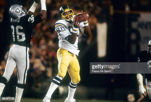 Tight End Kellen Winslow of the San Diego Chargers makes the catch in front of defensive back Mike Davis of the Oakland Raiders circa 1980 during an...