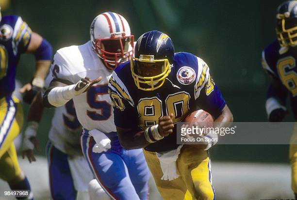 Tight End Kellen Winslow of the San Diego Chargers tries to get away from linebacker Robert Abraham of the Houston Oilers September 16 1984 during an...