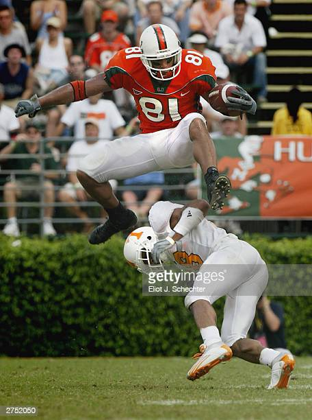Tight end Kellen Winslow of the University of Miami Hurricanes jumps over defensive back Jason Allen of the University of Tennessee Volunteers during...