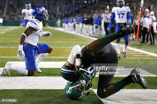 Tight end Kendall Ardoin of the Tulane Green Wave scores a touchdown over defensive back Arthur Maulet of the Memphis Tigers during the first half of...