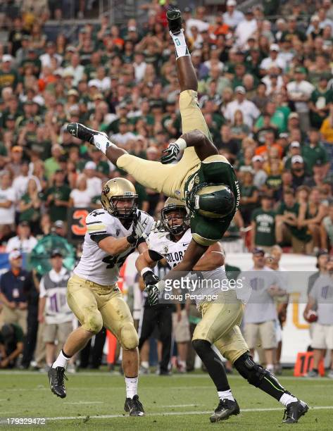 Tight end Kivon Cartwright of the Colorado State Rams attempts to make a pass reception and is upended by defensive back Parker Orms of the Colorado...