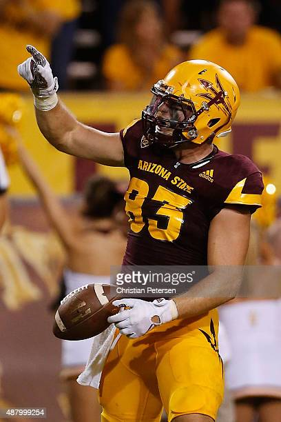 Tight end Kody Kohl of the Arizona State Sun Devils celebrates after scoring on a 10 yard touchdown reception against the Cal Poly Mustangs during...