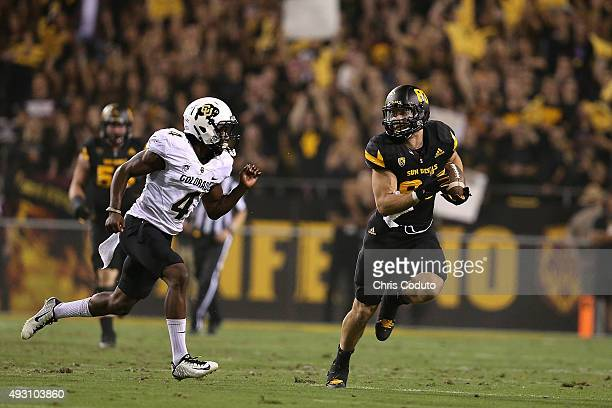 Tight end Kody Kohl of the Arizona State Sun Devils runs past defensive back Chidobe Awuzie of the Colorado Buffaloes during the second quarter of...