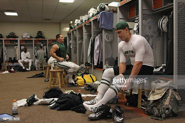 Tight End Konrad Reuland of the New York Jets gets pdressed in the locker room before the game against the Cincinnati Bengals at Paul Brown Stadium...
