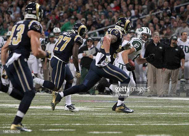 Tight End Konrad Reuland of the New York Jets has a long gain against the St Louis Rams at Edward Jones Dome on November 18 2012 in St Louis Missouri