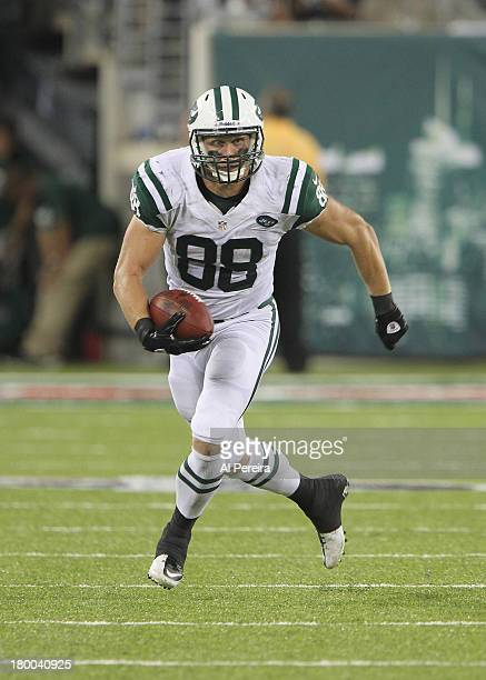 Tight End Konrad Reuland of the New York Jets has a long gain against the Philadelphia Eagles at MetLife Stadium on August 29 2013 in East Rutherford...