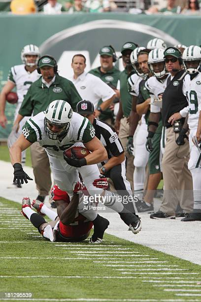 Tight End Konrad Reuland of the New York Jets has a long gain against the Tampa Bay Buccaneers at MetLife Stadium on September 8 2013 in East...
