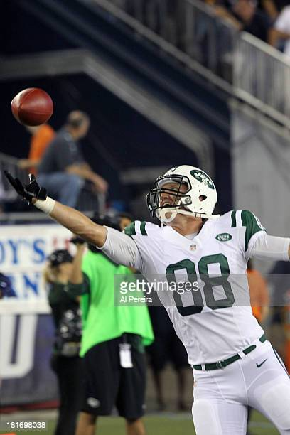 Tight End Konrad Reuland of the New York Jets makes a catch against the New England Patriots on a rainy night at Gillette Stadium on September 12...