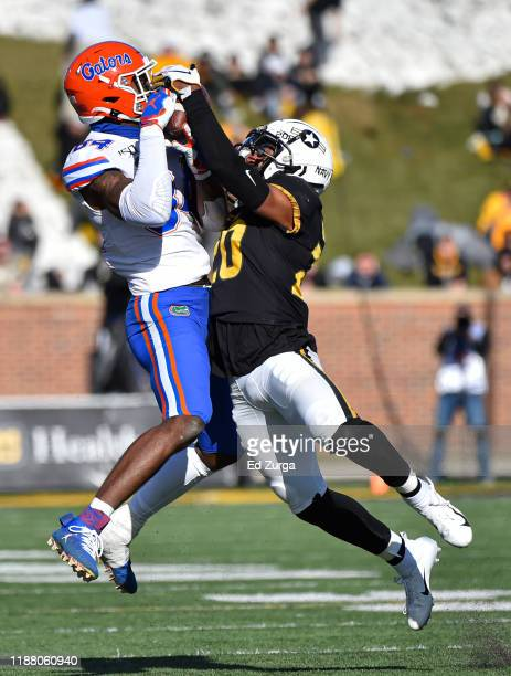 Tight end Kyle Pitts of the Florida Gators catches a pass against defensive back Khalil Oliver of the Missouri Tigers in the third quarter at Faurot...