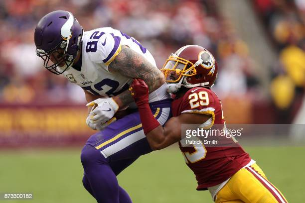 Tight end Kyle Rudolph of the Minnesota Vikings is tackled by cornerback Kendall Fuller of the Washington Redskins during the second quarter at...