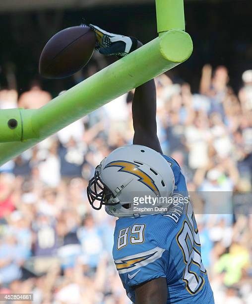 Tight end Ladarius Green of the San Diego Chargers spikes the ball over the goalpost after scoring on a 30 yard touchdown pass play in the second...