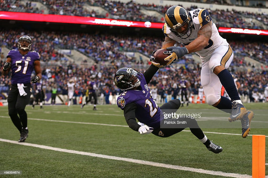 Tight end Lance Kendricks #88 of the St. Louis Rams scores a third quarter touchdown past cornerback Jimmy Smith #22 of the Baltimore Ravens at M&T Bank Stadium on November 22, 2015 in Baltimore, Maryland.