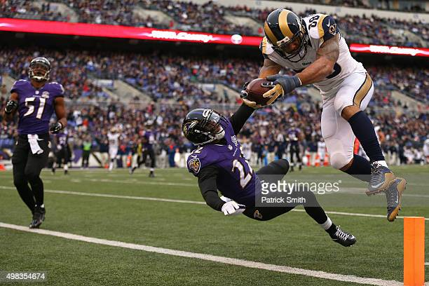 Tight end Lance Kendricks of the St Louis Rams scores a third quarter touchdown past cornerback Jimmy Smith of the Baltimore Ravens at MT Bank...