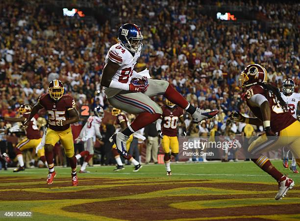 Tight end Larry Donnell of the New York Giants catches a pass for a touchdown against the Washington Redskins during their game at FedExField on...