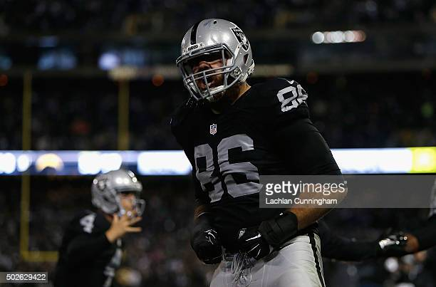 Tight end Lee Smith of the Oakland Raiders celebrates a touchdown scored by teammate Michael Crabtree in the fourth quarter against the San Diego...