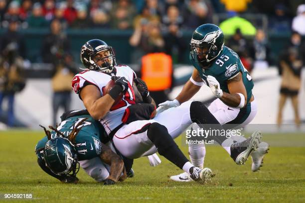 tight end Levine Toilolo of the Atlanta Falcons makes a catch for a first down against cornerback Ronald Darby and outside linebacker Mychal...