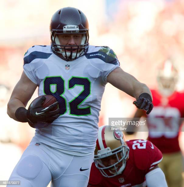 Tight end Luke Willson of the Seattle Seahawks breaks free for a 39yard touchdown against cornerback Carlos Rogers of the San Francisco 49ers in the...