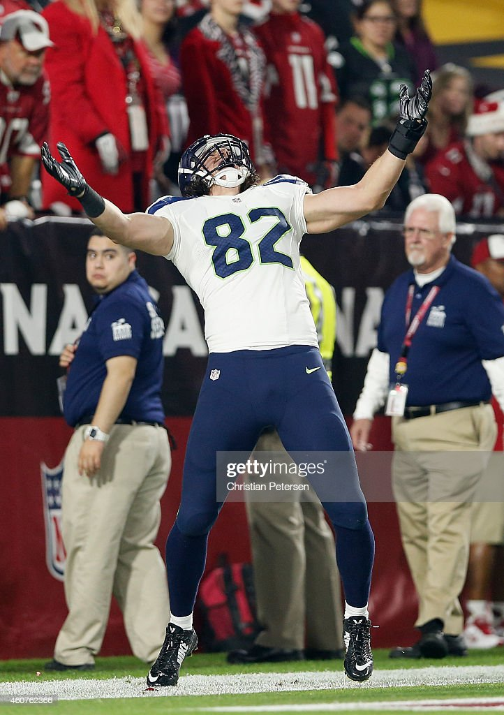Tight end Luke Willson #82 of the Seattle Seahawks celebrates after scoring an 80 yard touchdown reception in the second quarter during the NFL game against the Arizona Cardinals at the University of Phoenix Stadium on December 21, 2014 in Glendale, Arizona.