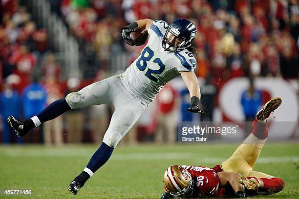 Tight end Luke Willson of the Seattle Seahawks gets upended by linebacker Chris Borland of the San Francisco 49ers after picking up a first down in...