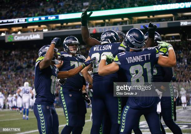 Tight end Luke Willson of the Seattle Seahawks is mobbed by teammates after scoring a touchdown against the Indianapolis Colts in the fourth quarter...