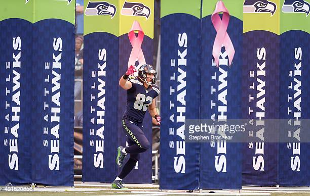 Tight End Luke Willson of the Seattle Seahawks runs on to the field during player introduction before a football game against the Detroit Lions at...