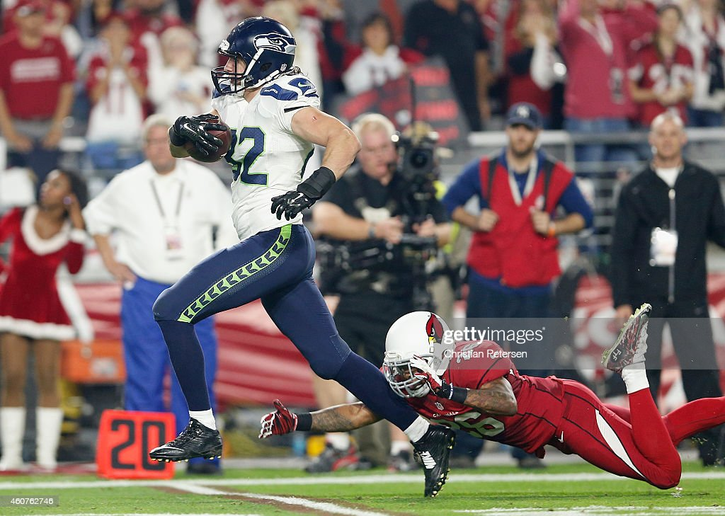 Tight end Luke Willson #82 of the Seattle Seahawks runs the football against free safety Rashad Johnson #26 of the Arizona Cardinals to score a 80 yard touchdown reception in the second quarter at the University of Phoenix Stadium on December 21, 2014 in Glendale, Arizona.
