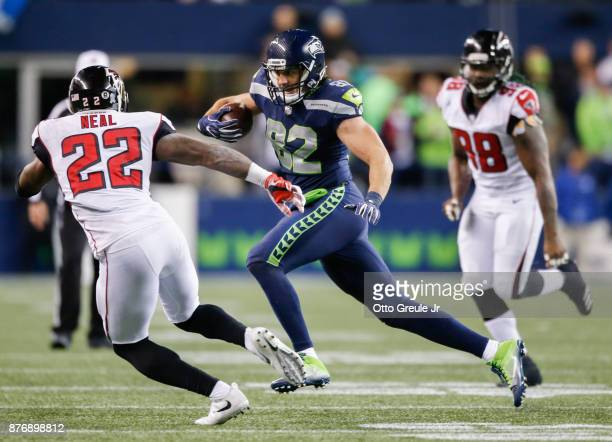 Tight end Luke Willson of the Seattle Seahawks rushes against strong safety Keanu Neal of the Atlanta Falcons during the third quarter of the game at...